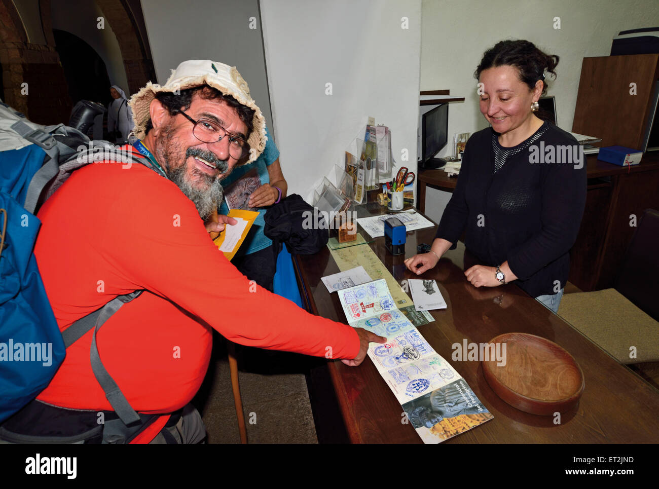 Spain, Galicia: Brazilian  St. James pilgrim Orlando after getting a stamp for his pilgrims pass in the church of - Stock Image