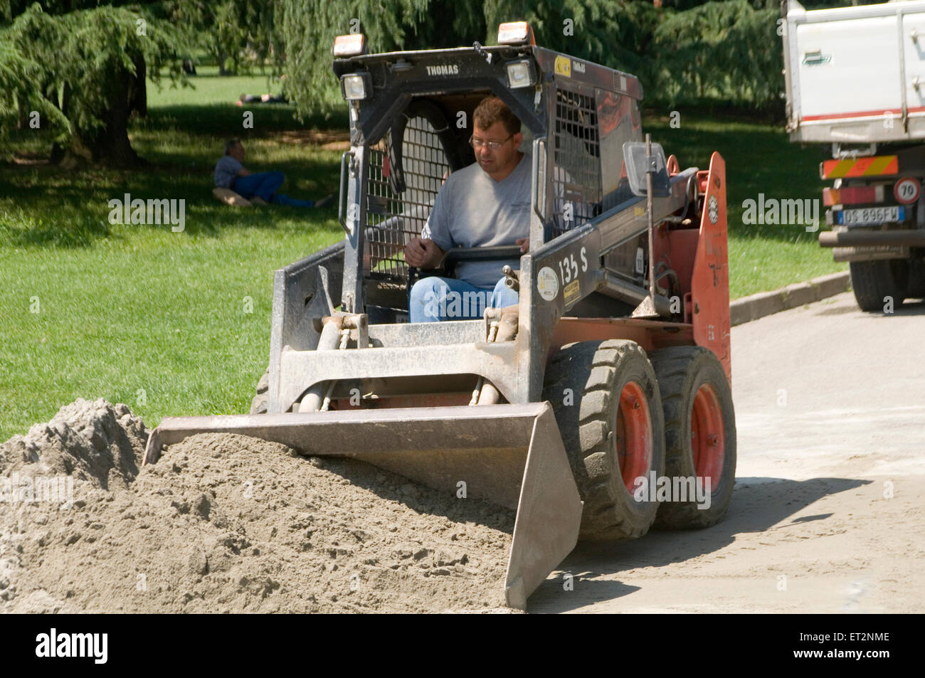 mini digger diggers bobcat earth mover movers earthmover earthmovers - Stock Image
