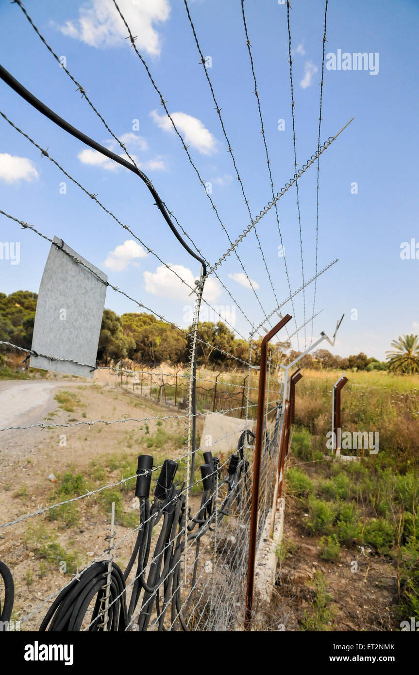 The Israeli Jordanian Border Photographed at Naharaim on the Jordan River Hitech touch activated security fence - Stock Image