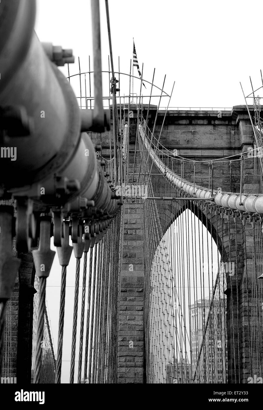 The Brooklyn Bridge spanning the East River from Manhattan to Brooklyn. The Bridge is a hybrid cable-stayed suspension - Stock Image