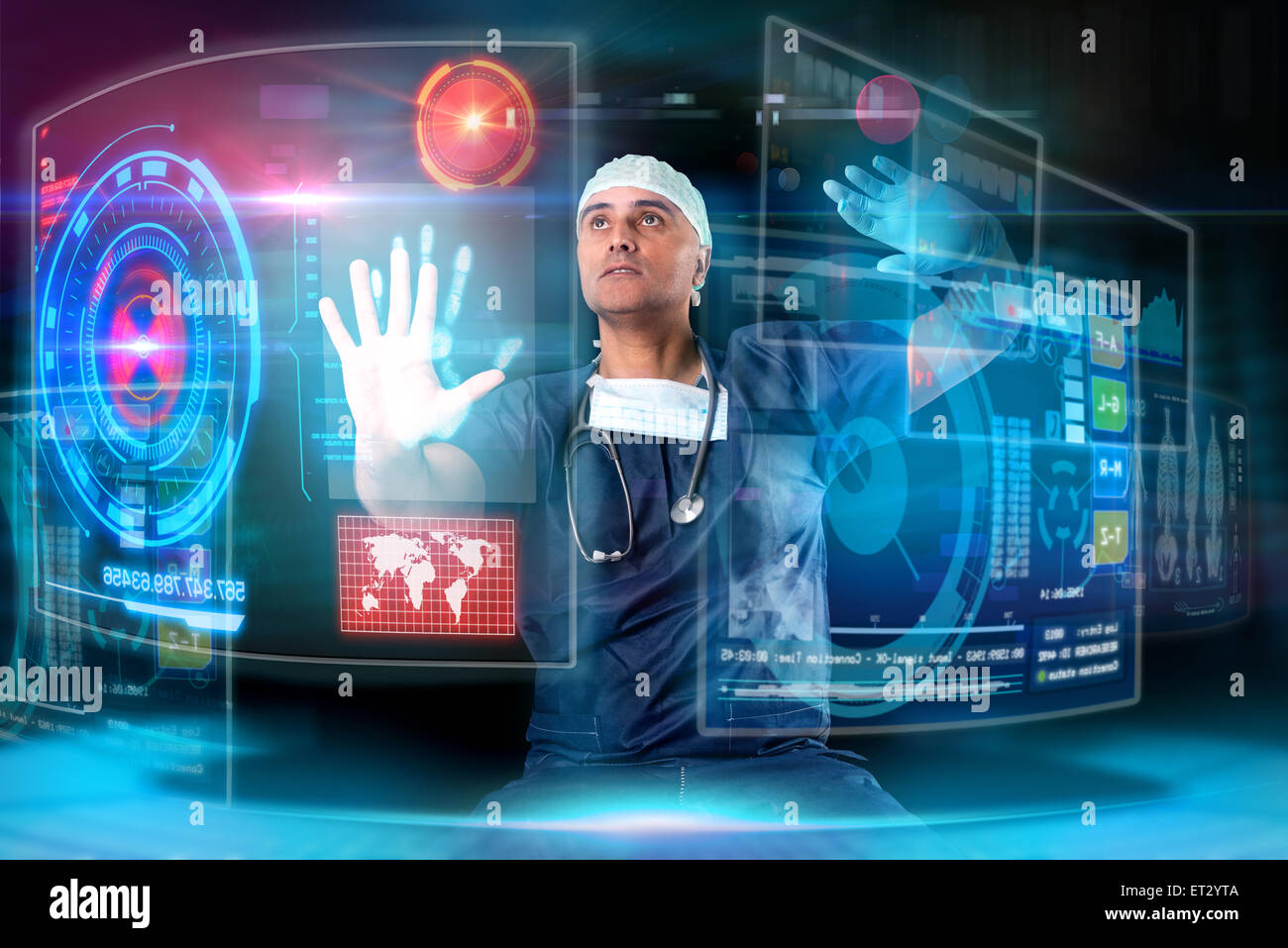 Doctor in uniform with digital  screens and keyboard - Stock Image
