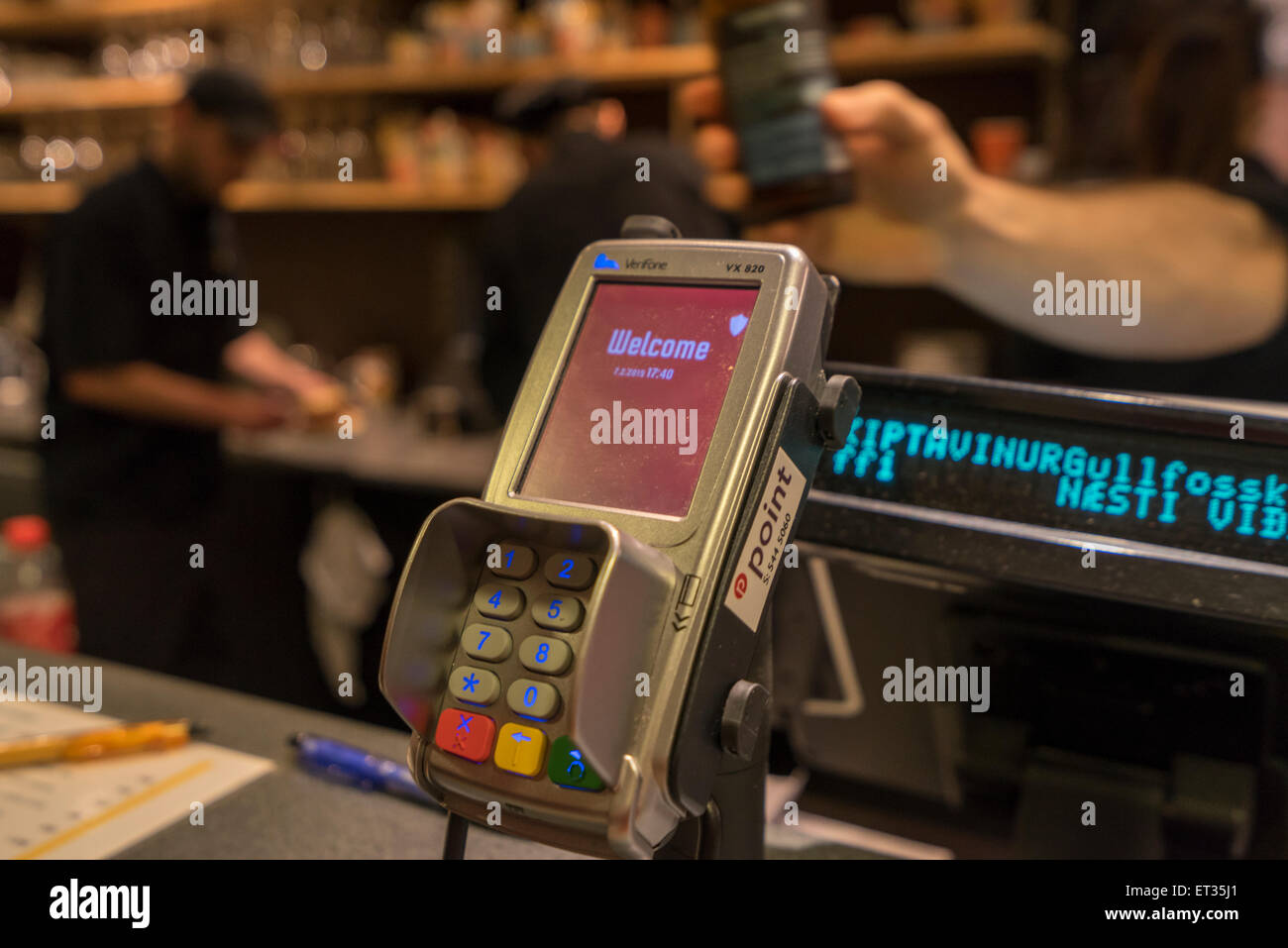 Credit card reader in small cafe, Iceland - Stock Image