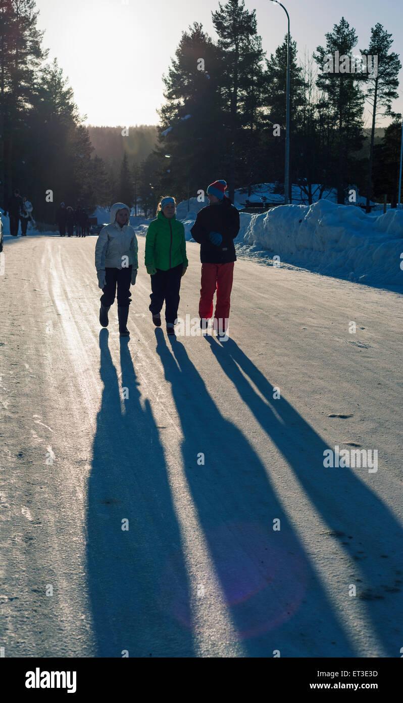 Arctic Circle, Lapland, Scandinavia, Sweden, Jokkmokk,, shadow of local teenagers - Stock Image