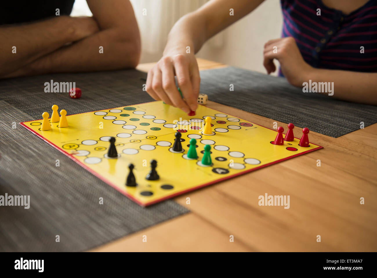Mid section of father and daughter playing a board game, Bavaria,  Germany - Stock Image