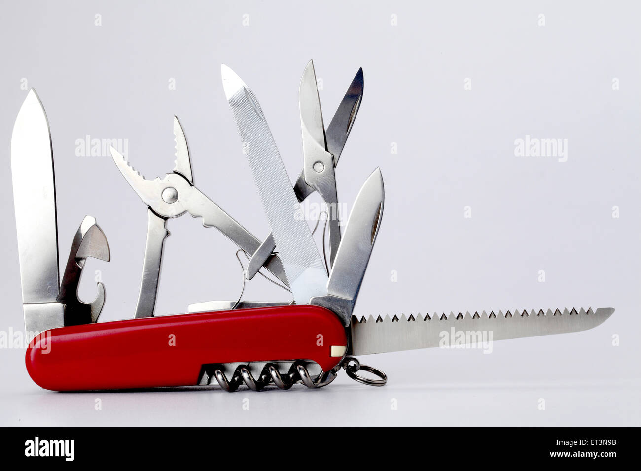 All purpose swiss army knife on white - Stock Image