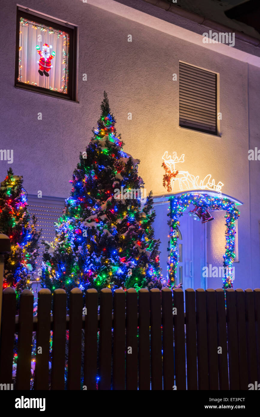 Decorated Christmas tree outside house, Bavaria, Germany - Stock Image