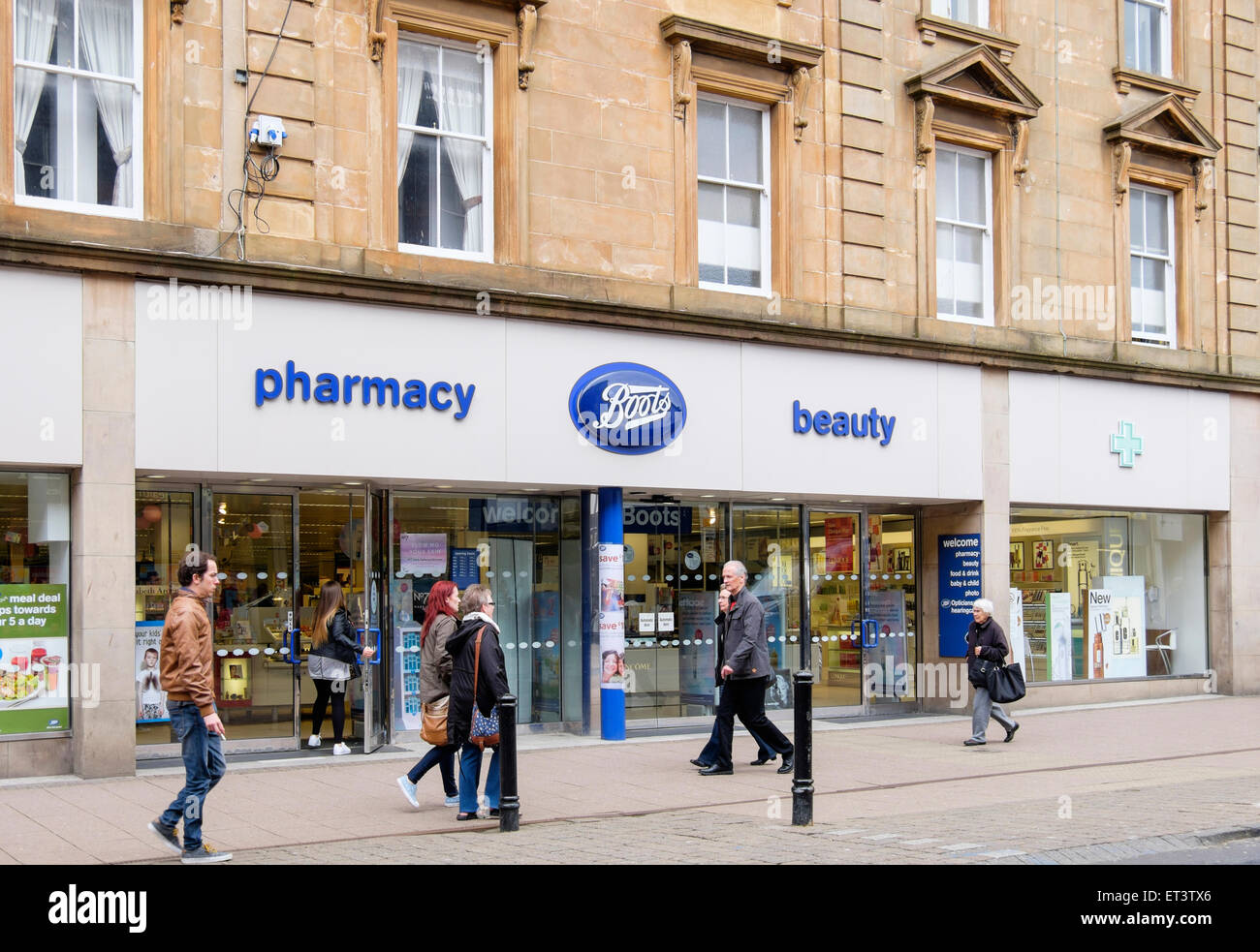 Boots pharmacy chemist store shop front with shoppers passing outside on High Street, Ayr, Ayrshire, Scotland, UK, - Stock Image