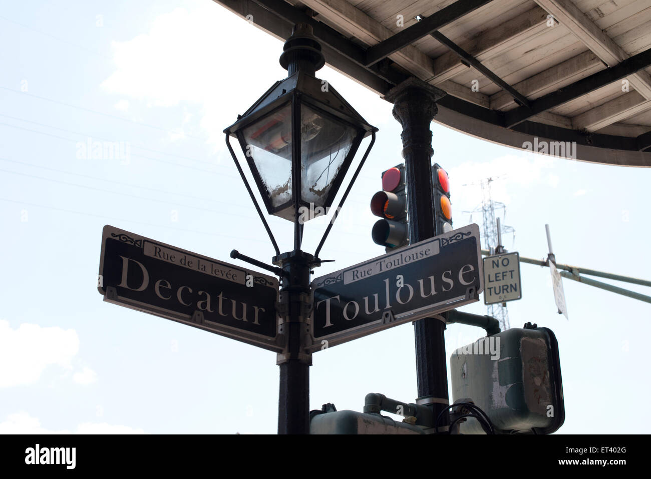 Street signs that mark the cross streets of decatur and Toulouse in New Orleans Louisiana - Stock Image