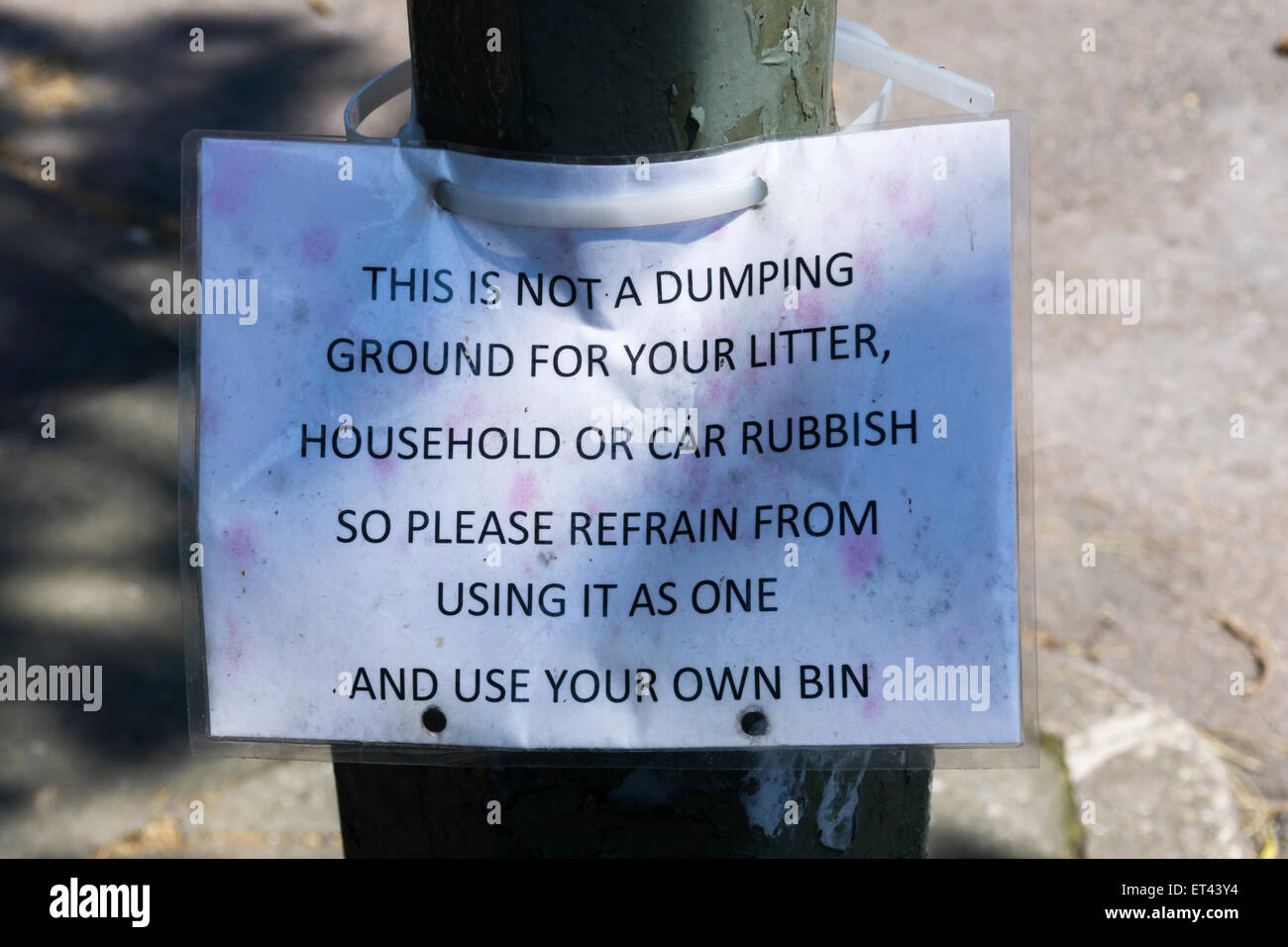 A homemade sign asking people to take their litter home and not dump it on the ground. - Stock Image