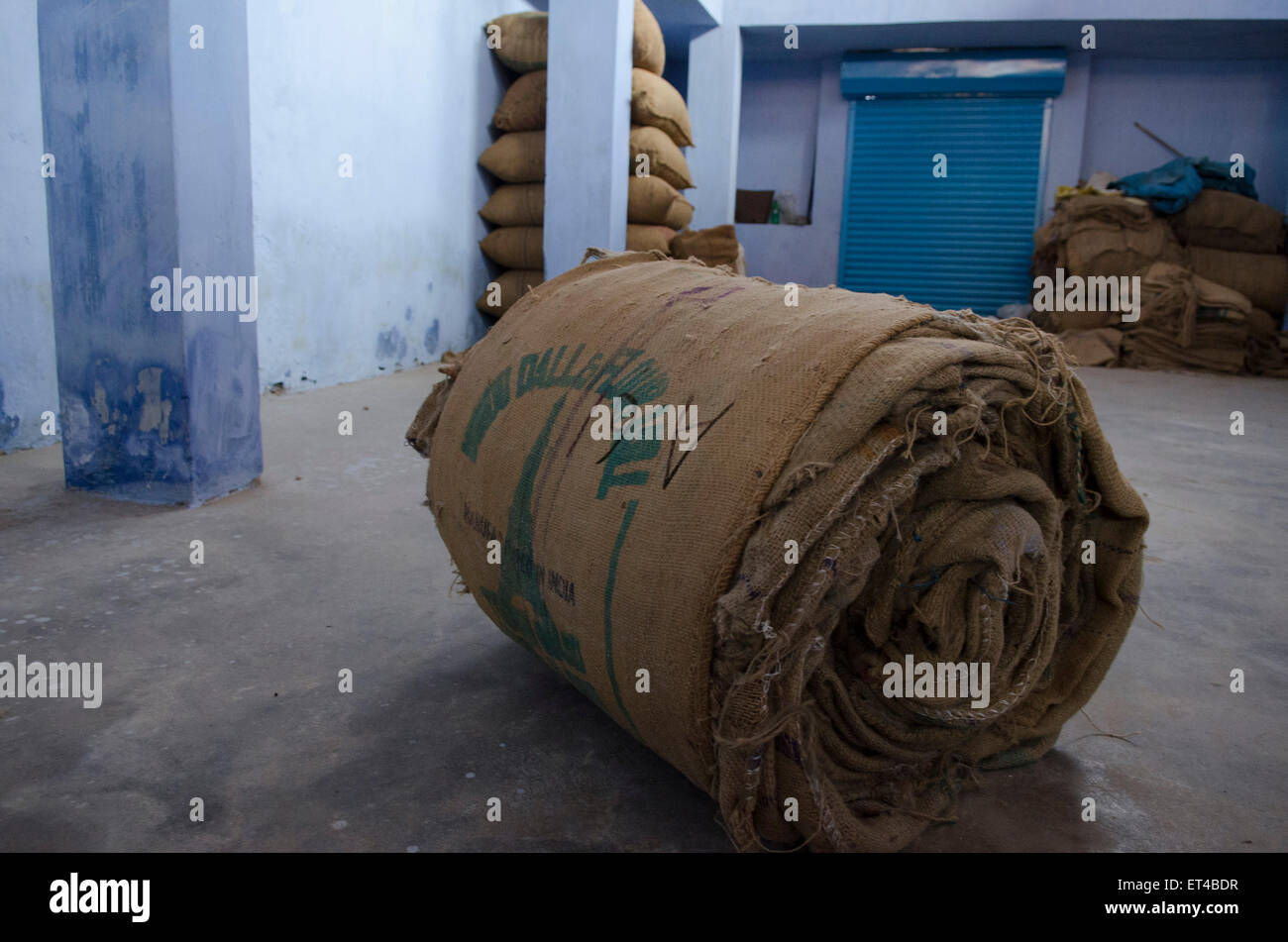 a roll of sacks lays unused in a ginger distribution warehouse in Fort Cochin, Kerala, south India - Stock Image
