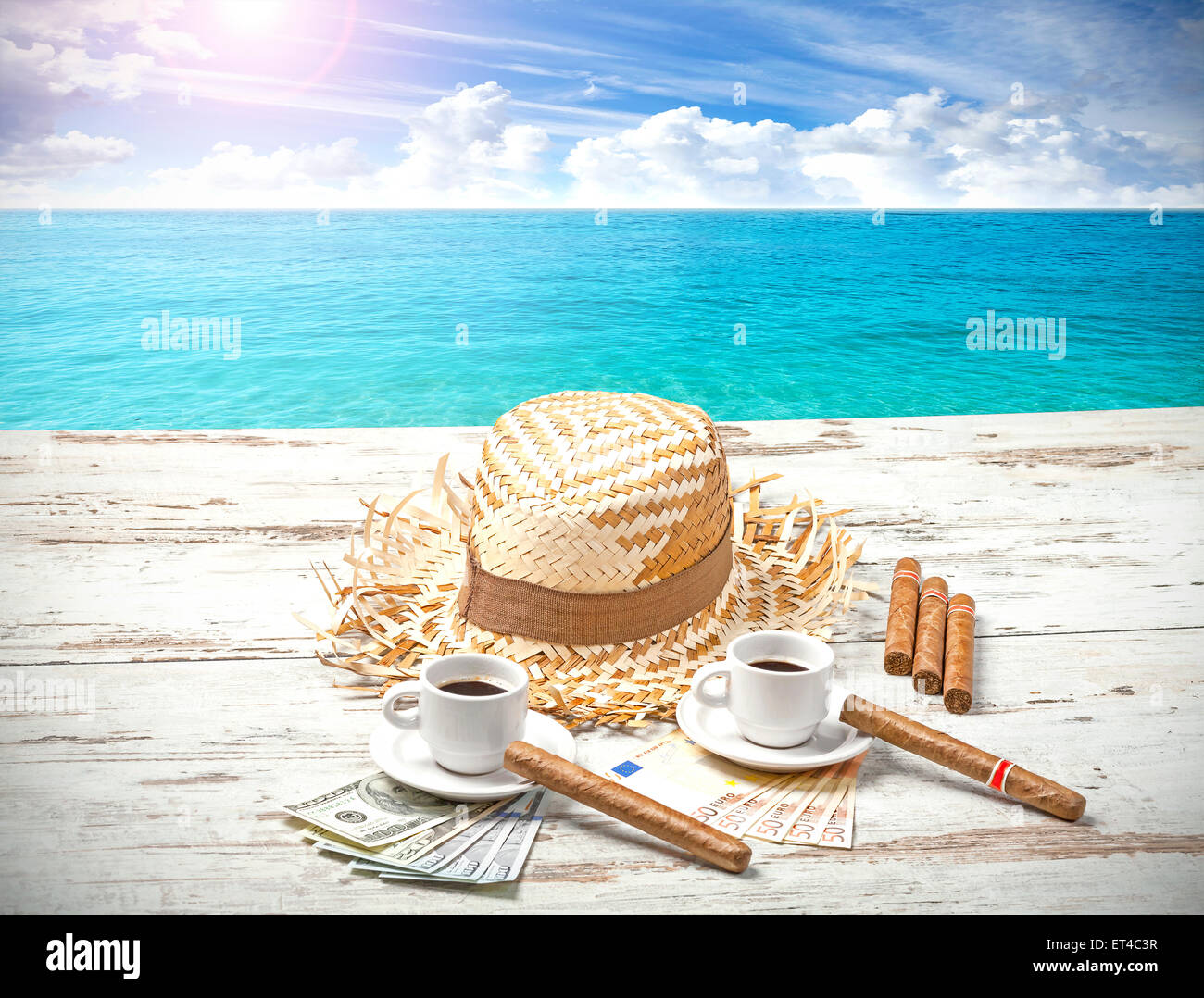 Coffees, cigars, money and hat on wooden beach table. Summer adventure concept. - Stock Image