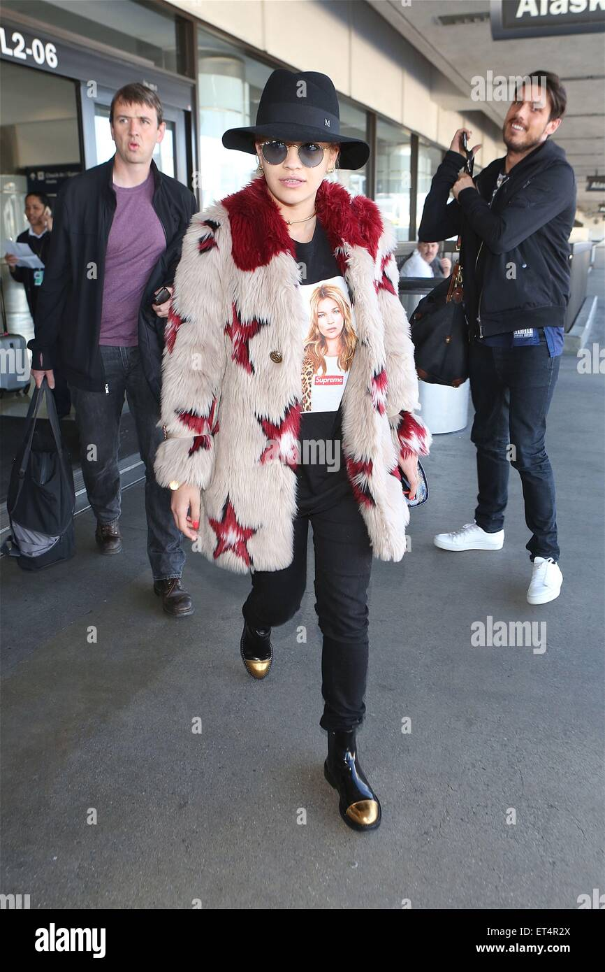 Rita Ora arrives from a flight to Los Angeles International Airport (LAX) wearing a faux fur star studded coat, - Stock Image