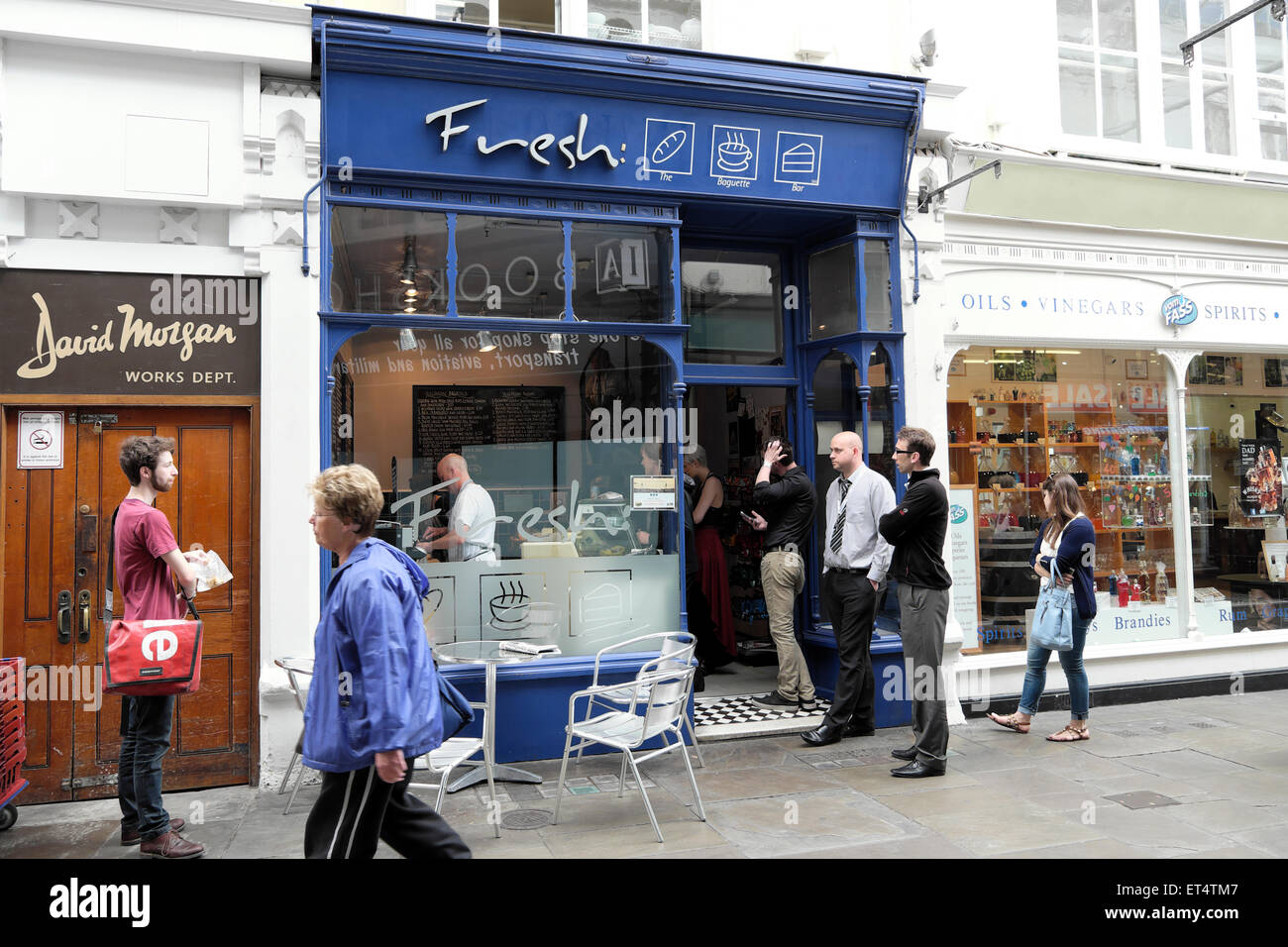 Workers queuing at Fresh sandwich shop at lunchtime for food in Royal Arcade, Cardiff City Centre, Wales UK  KATHY - Stock Image