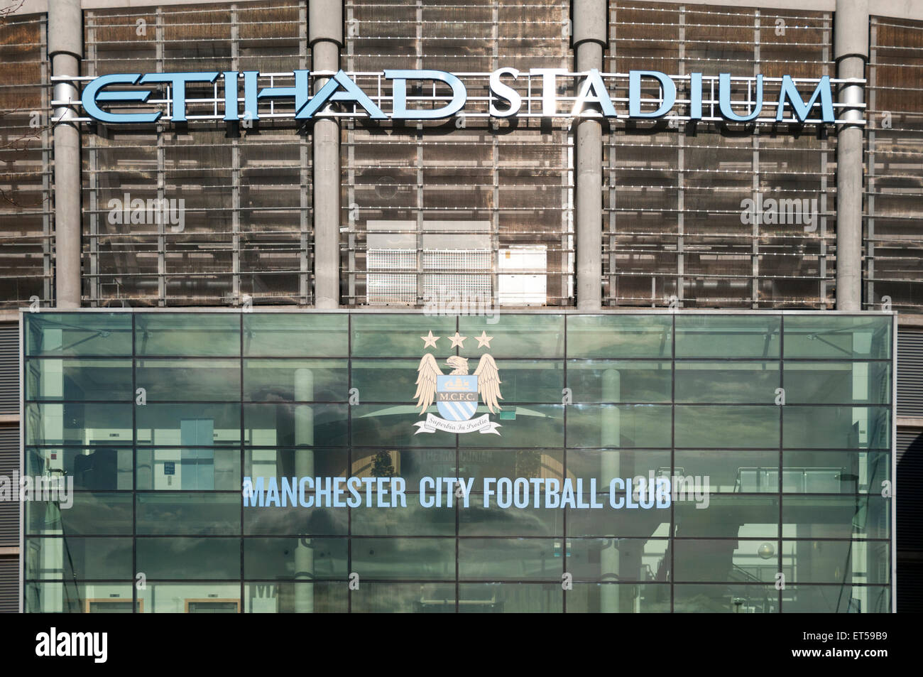 Signs above one of the entrances to the Etihad Stadium, Etihad Campus, Manchester, England, UK - Stock Image
