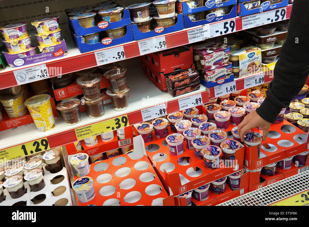 Custards and puddings in a supermarket - Stock Image