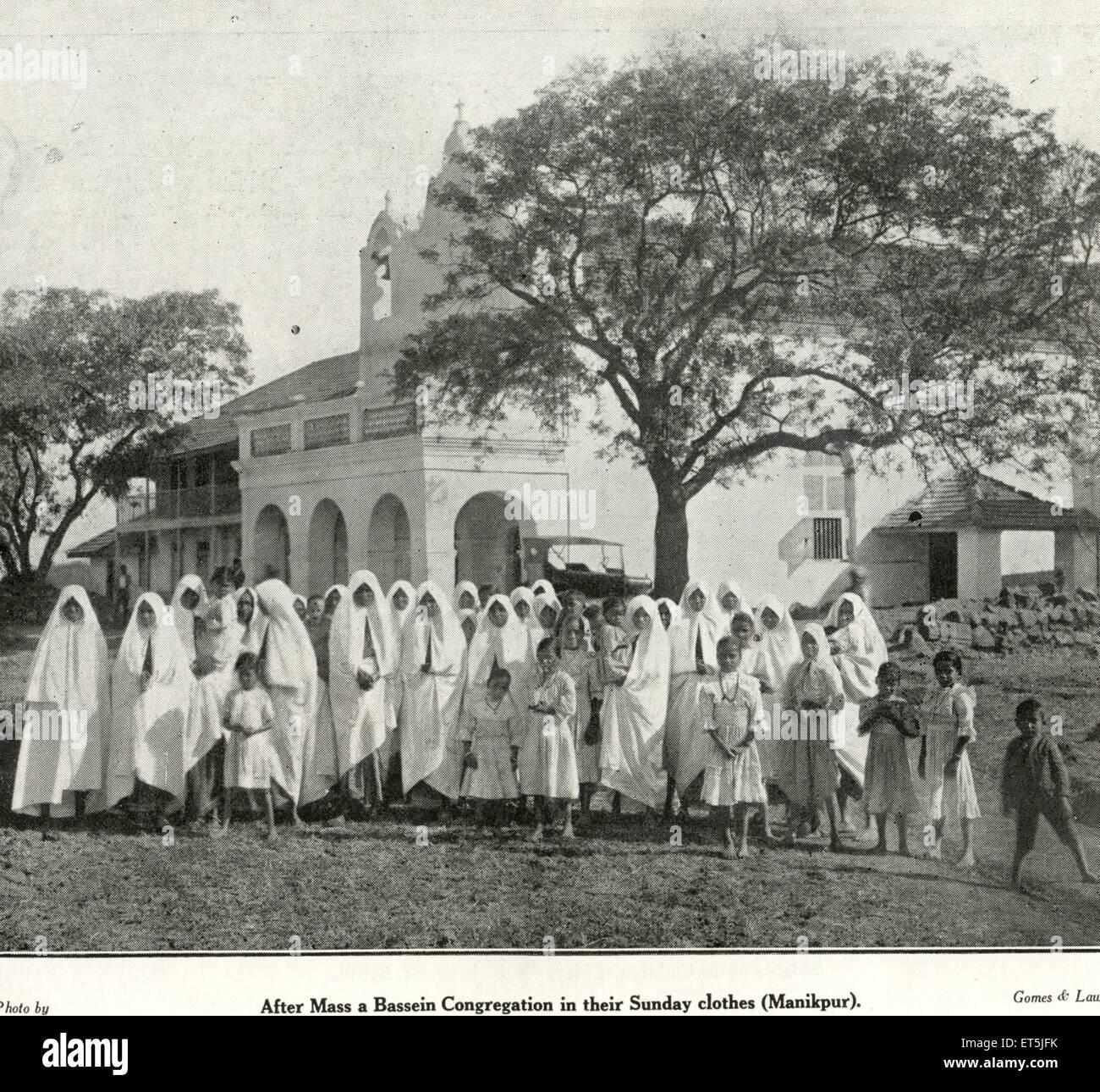 Catholic community after mass Bassein congregation in their Sunday clothes Manikpur ; Vasai ; Maharashtra ; India - Stock Image