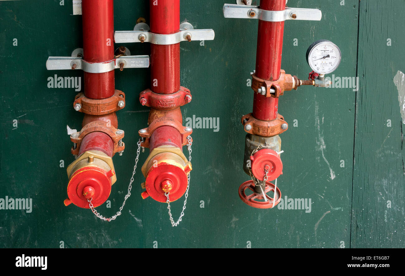 Pipes and pressure gage on a construction worksite - Stock Image