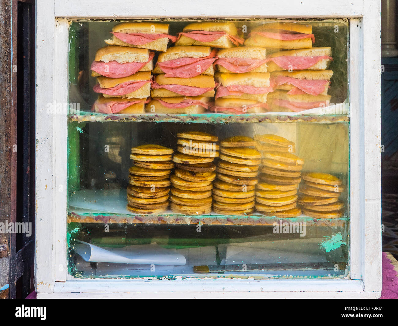 A  sandwich vendor's display case holding sandwiches and other foods in Santiago de Cuba. - Stock Image