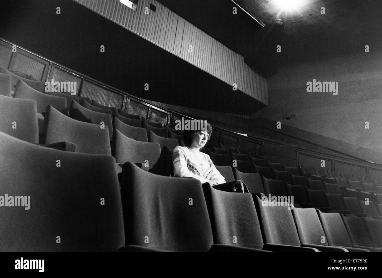 All alone in the darkness, Valerie Pearson going where the other 499 didn't treat, sitting through a private - Stock Image