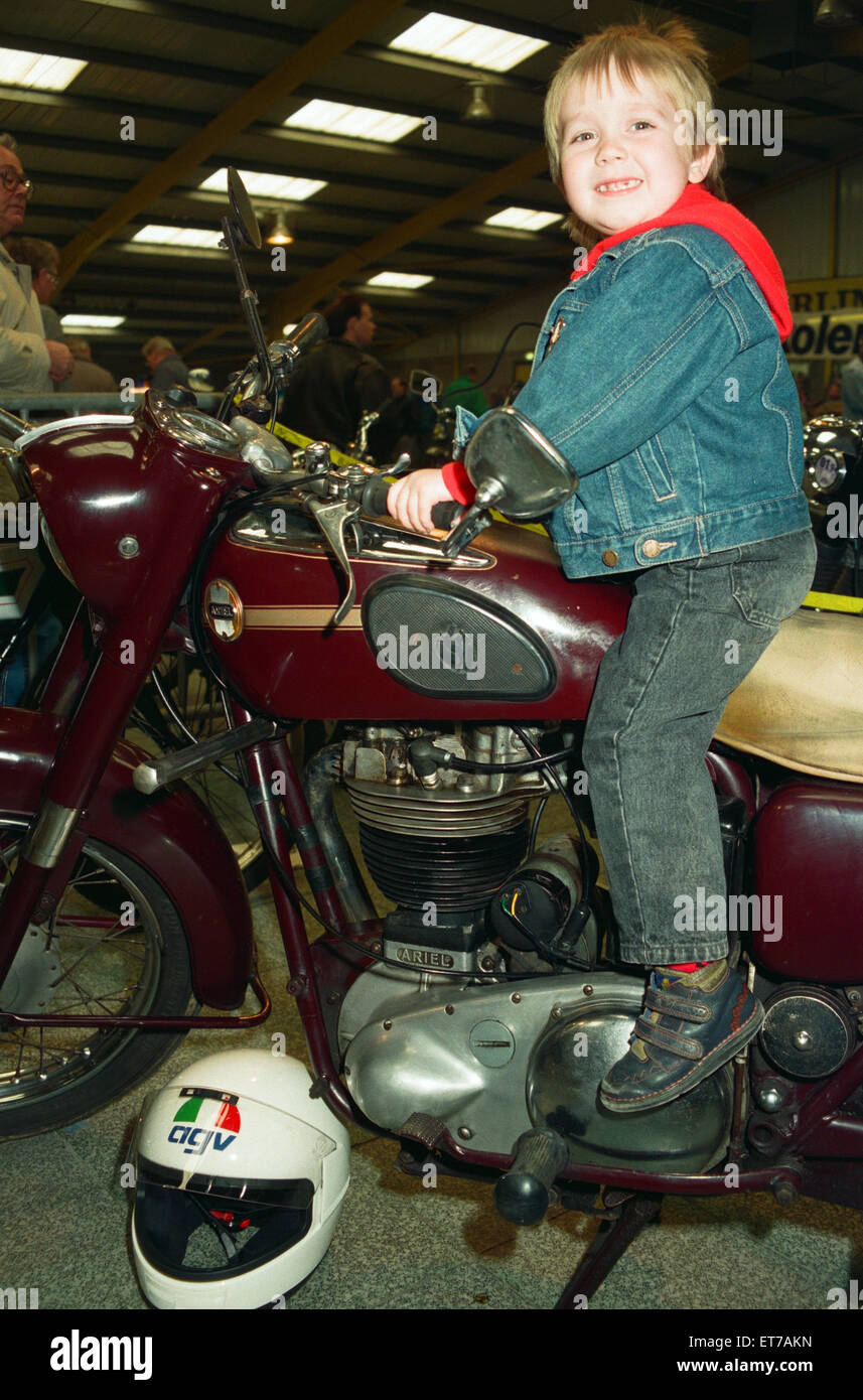 Michael Tilley, aged three and a half, tries out a 1956 Ariel 500cc at the Classic Bike Show. 28th March 1993. - Stock Image