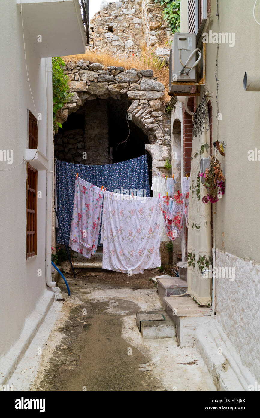 Laundry hanging to dry in a small alley in the village of Pyrgi, at the island of Chios, Greece - Stock Image