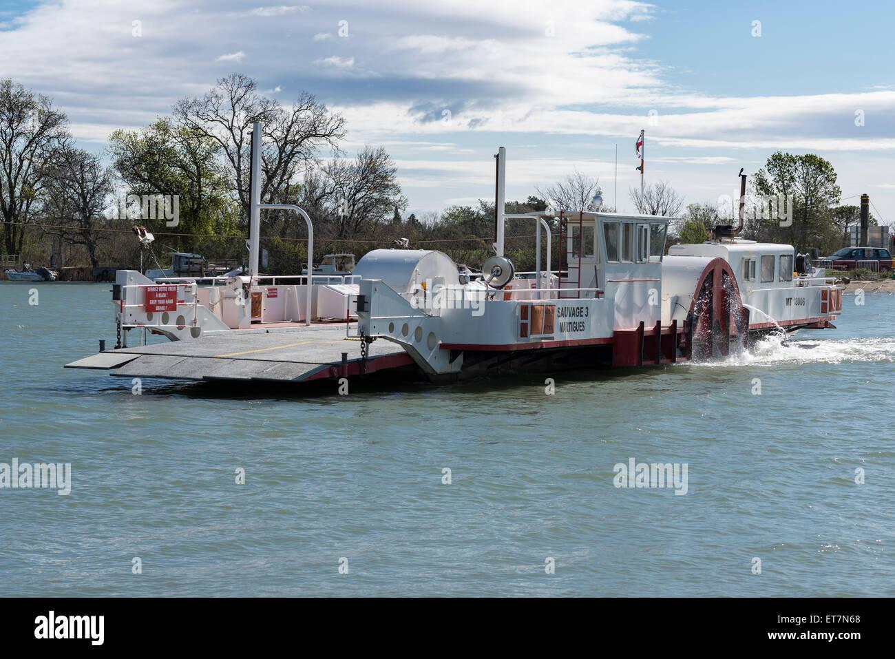 Ferry on the small Rhone, Camargue, Saintes-Maries-de-la-Mer, Provence-Alpes-Côte d'Azur, France - Stock Image
