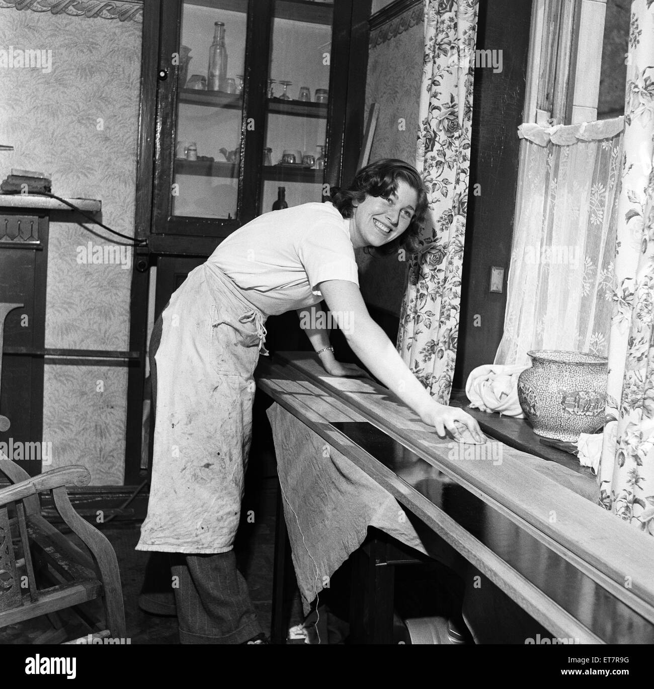 Miss Marie Fielding, the only woman French Polisher on the Isle of Man. She is only 22 years old and has been doing - Stock Image