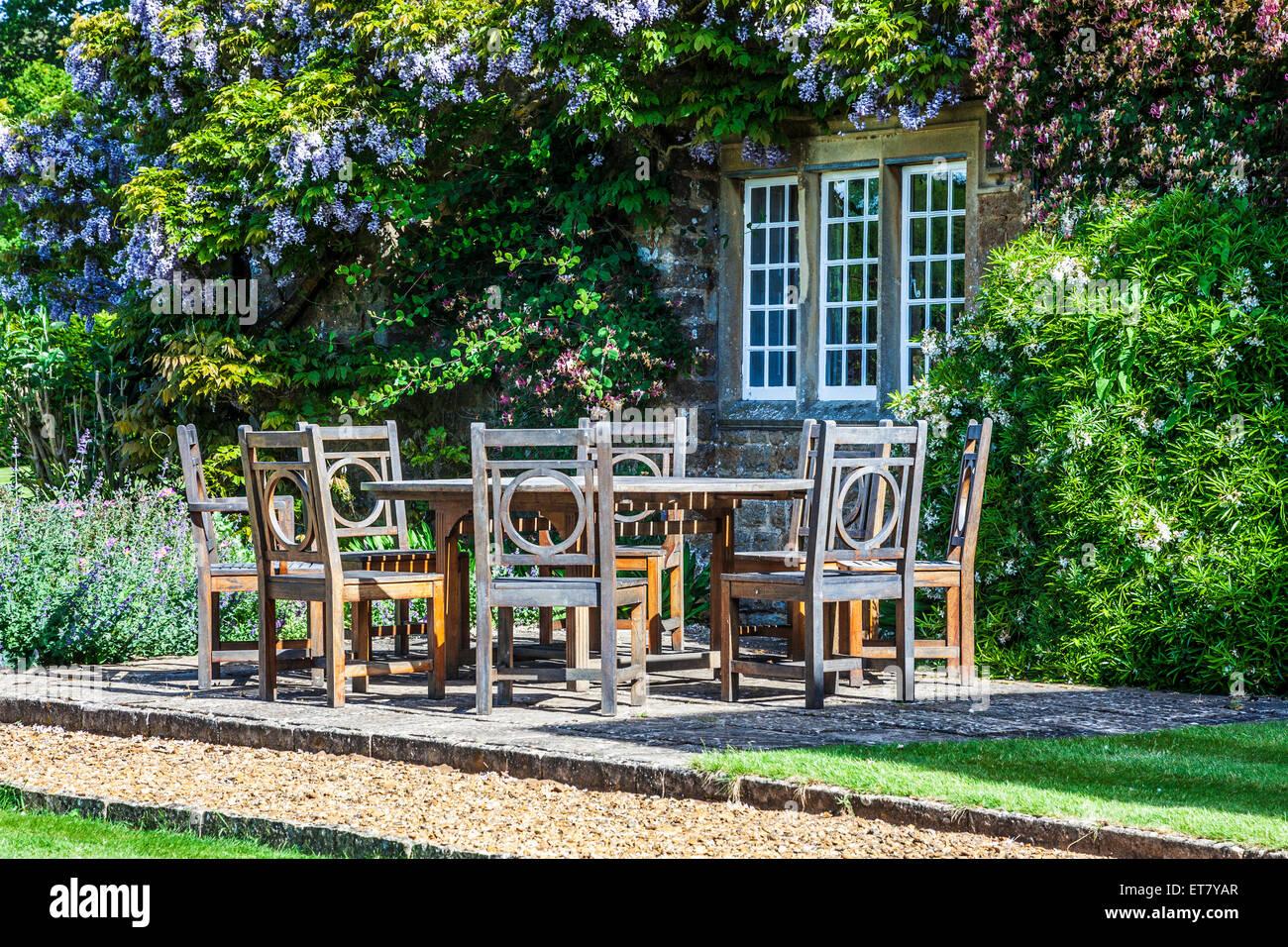 Patio furniture outside a Georgian Lodge. - Stock Image