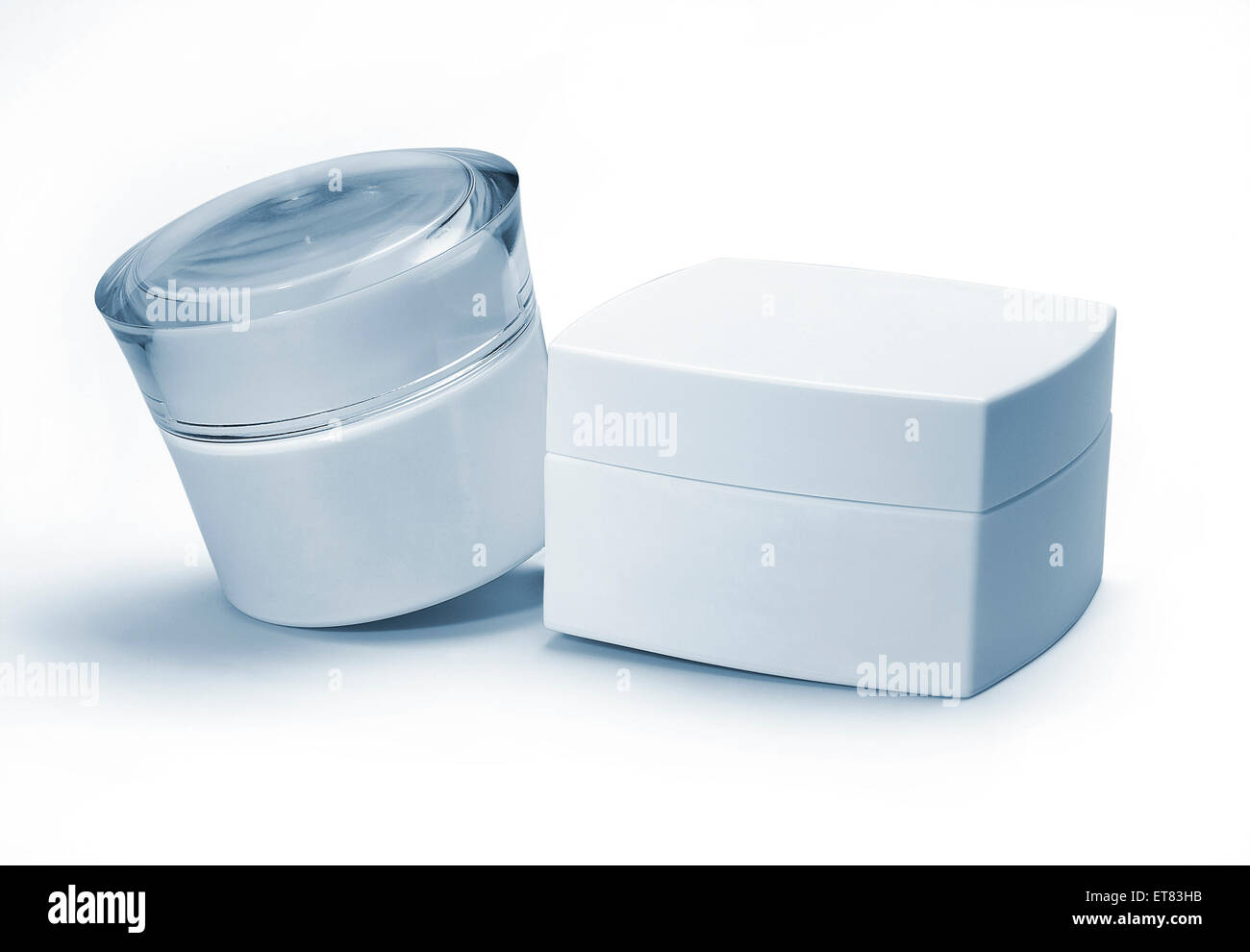 Two cosmetics containers. Blue tone. - Stock Image