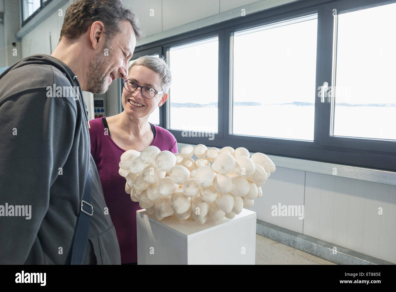 Couple looking at egg shell lampshade in an art museum, Bavaria, Germany - Stock Image