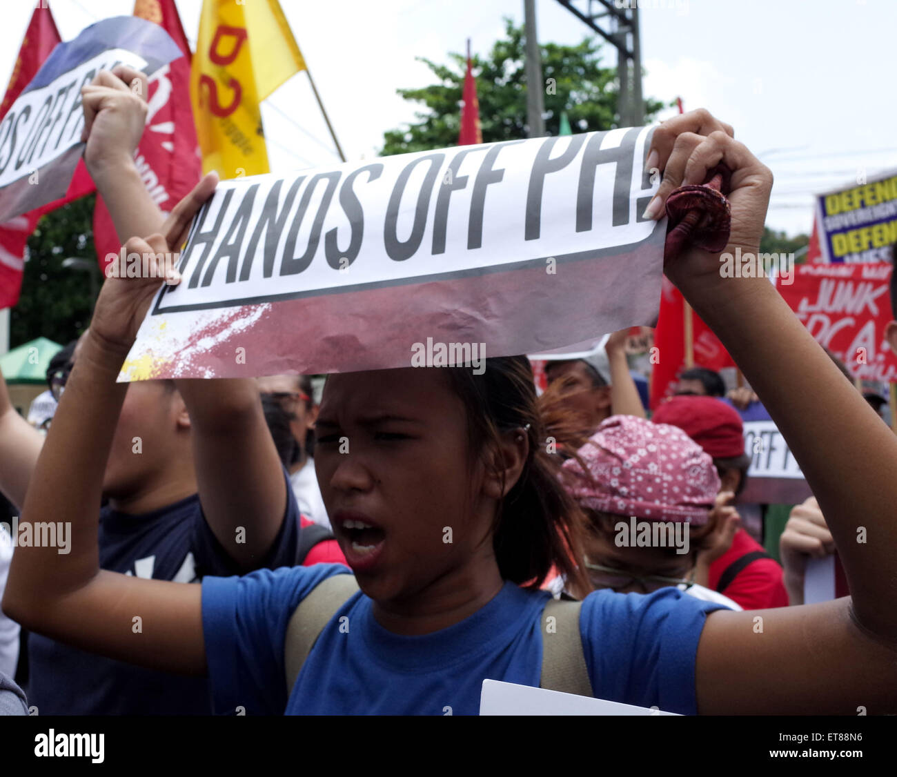 Manila, Philippines. 12th June, 2015. A protester shouts a slogan during a protest action outside the US Embassy, - Stock Image