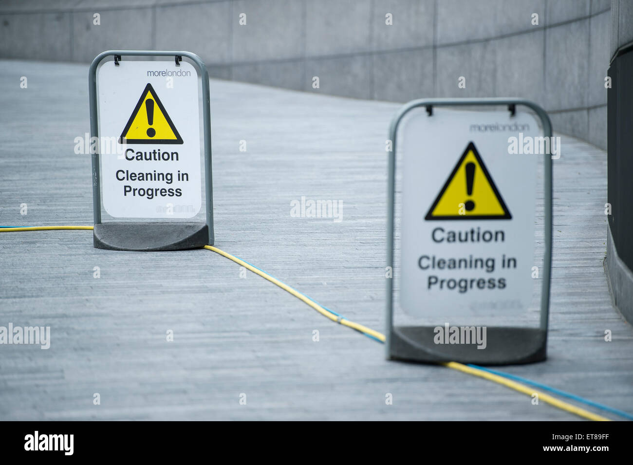 Caution signs, cleaning in progress outside City Hall in London - Stock Image
