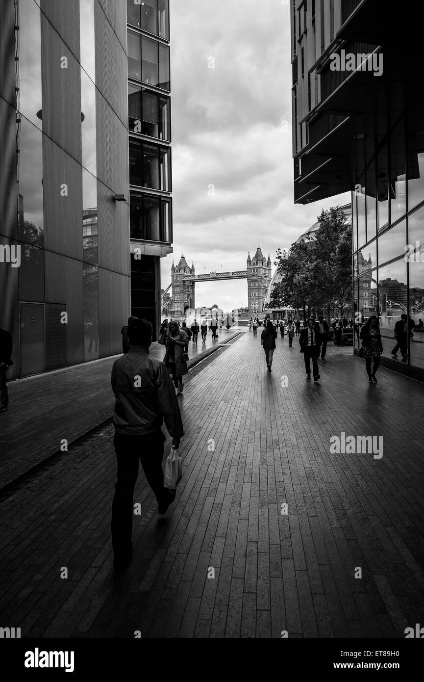 A view of Tower Bridge from between the buildings of More London - Stock Image