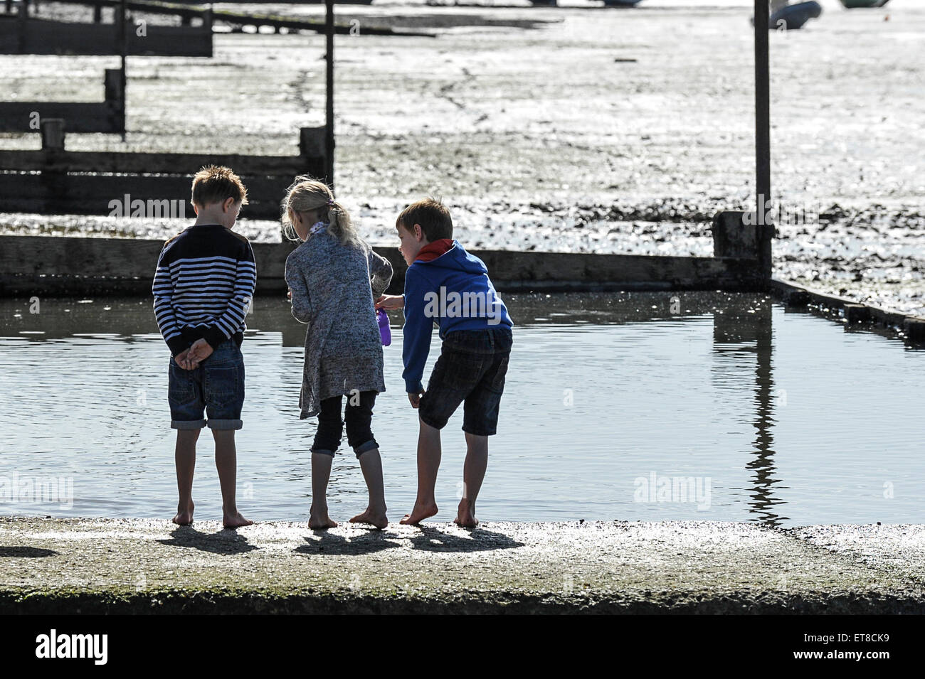 Children playing on the foreshore at Leigh on Sea in Essex. - Stock Image