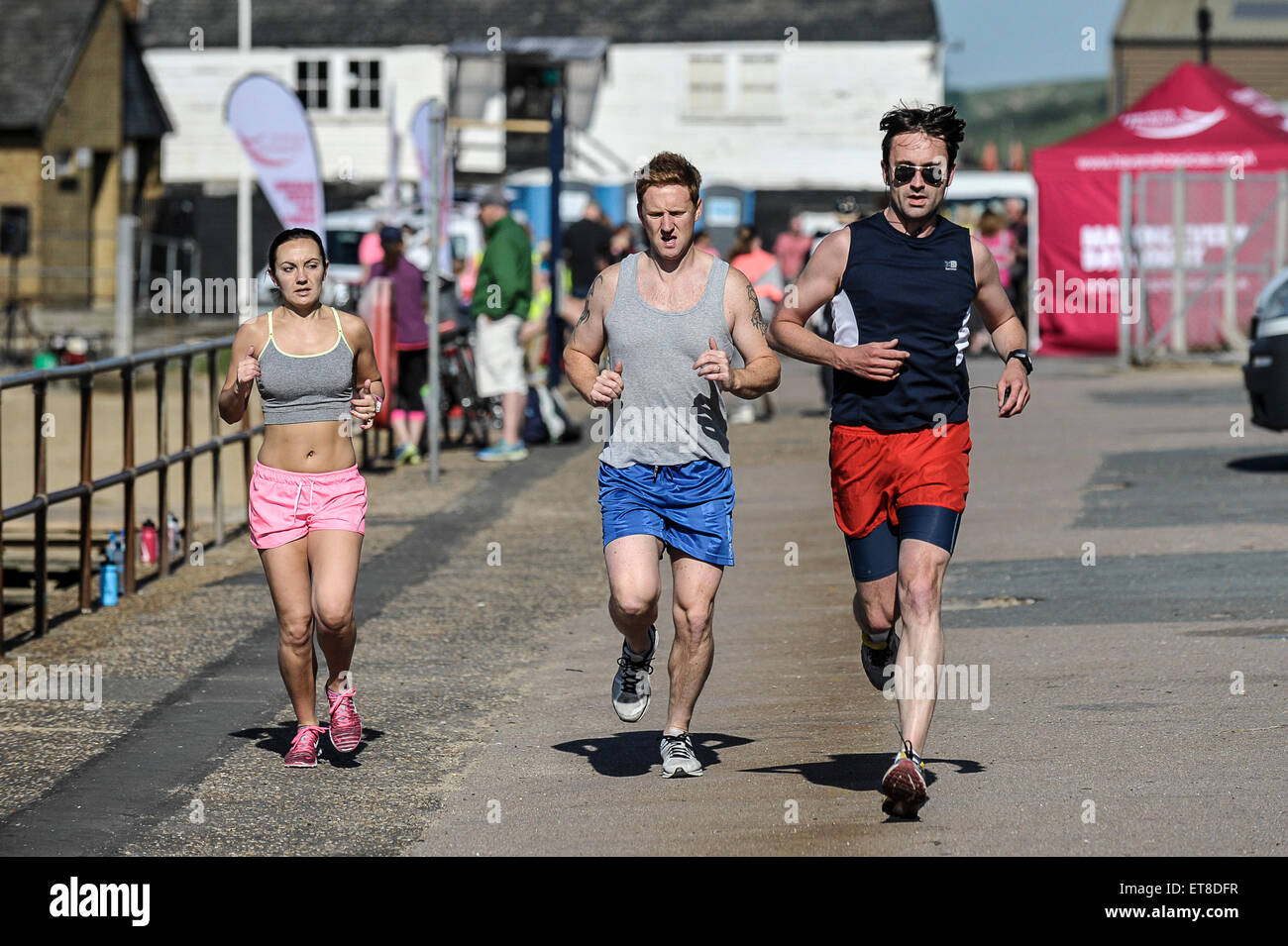 Joggers running at Leigh on Sea in Essex. - Stock Image