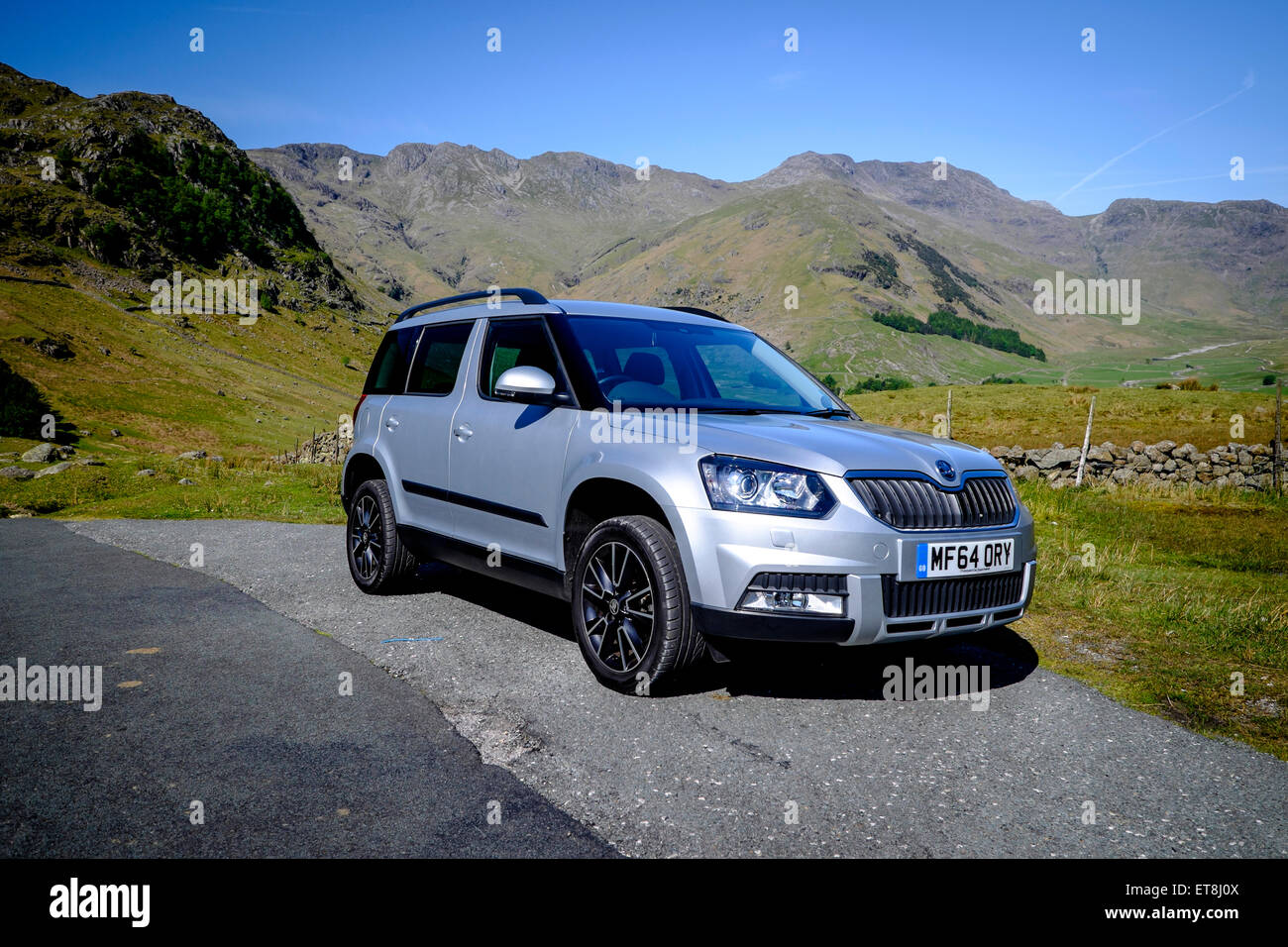 Skoda Yeti Parked at roadside with views over the lakeland fells in Cumbria - Stock Image
