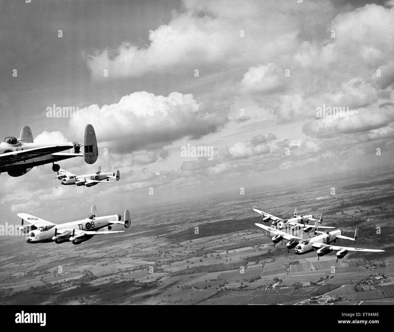 Avro Lancasters bomber from 35 Squadron in flight over the English  countryside. 29th May 1946. - Stock Image