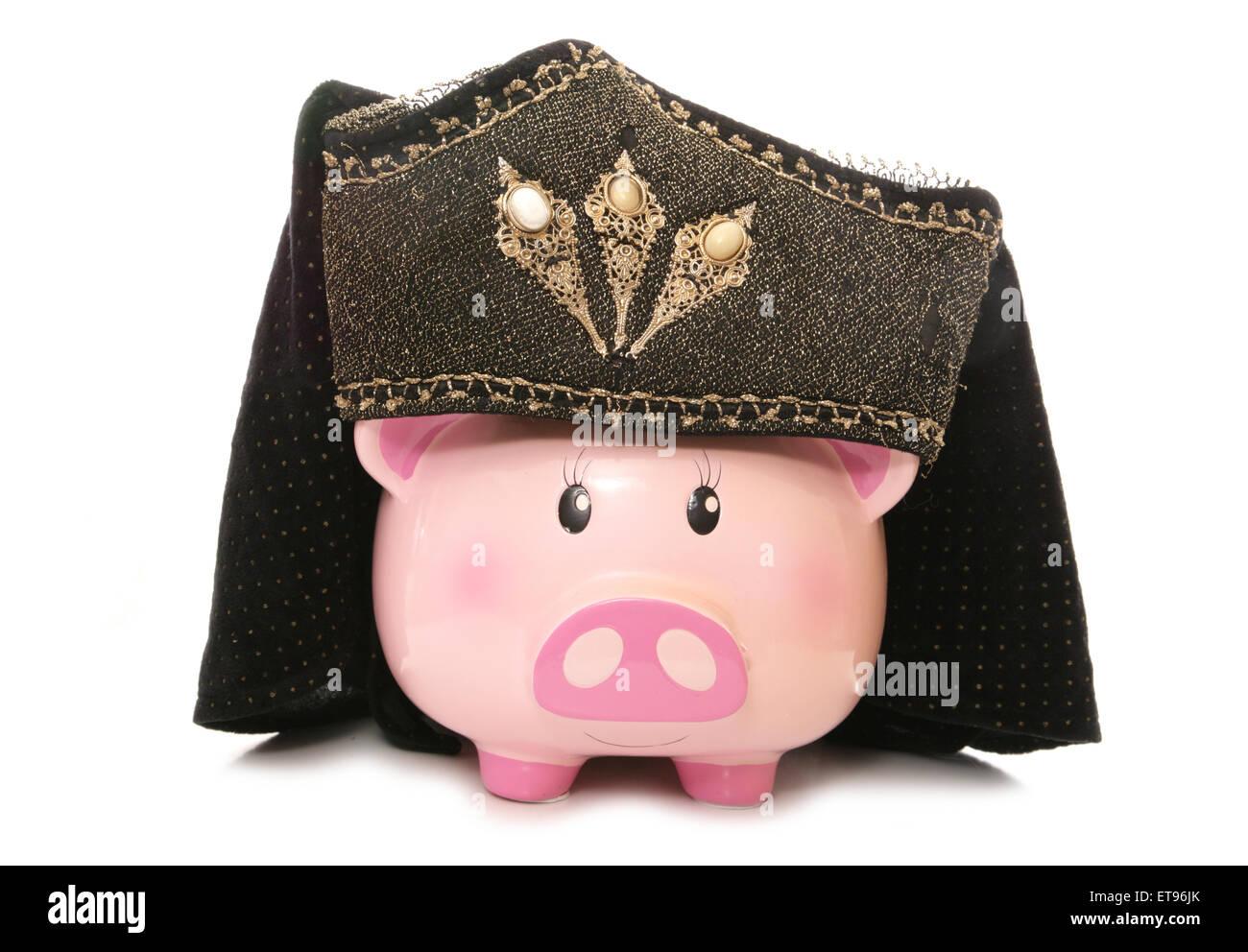 piggy bank wearing tudor headdress cutout - Stock Image
