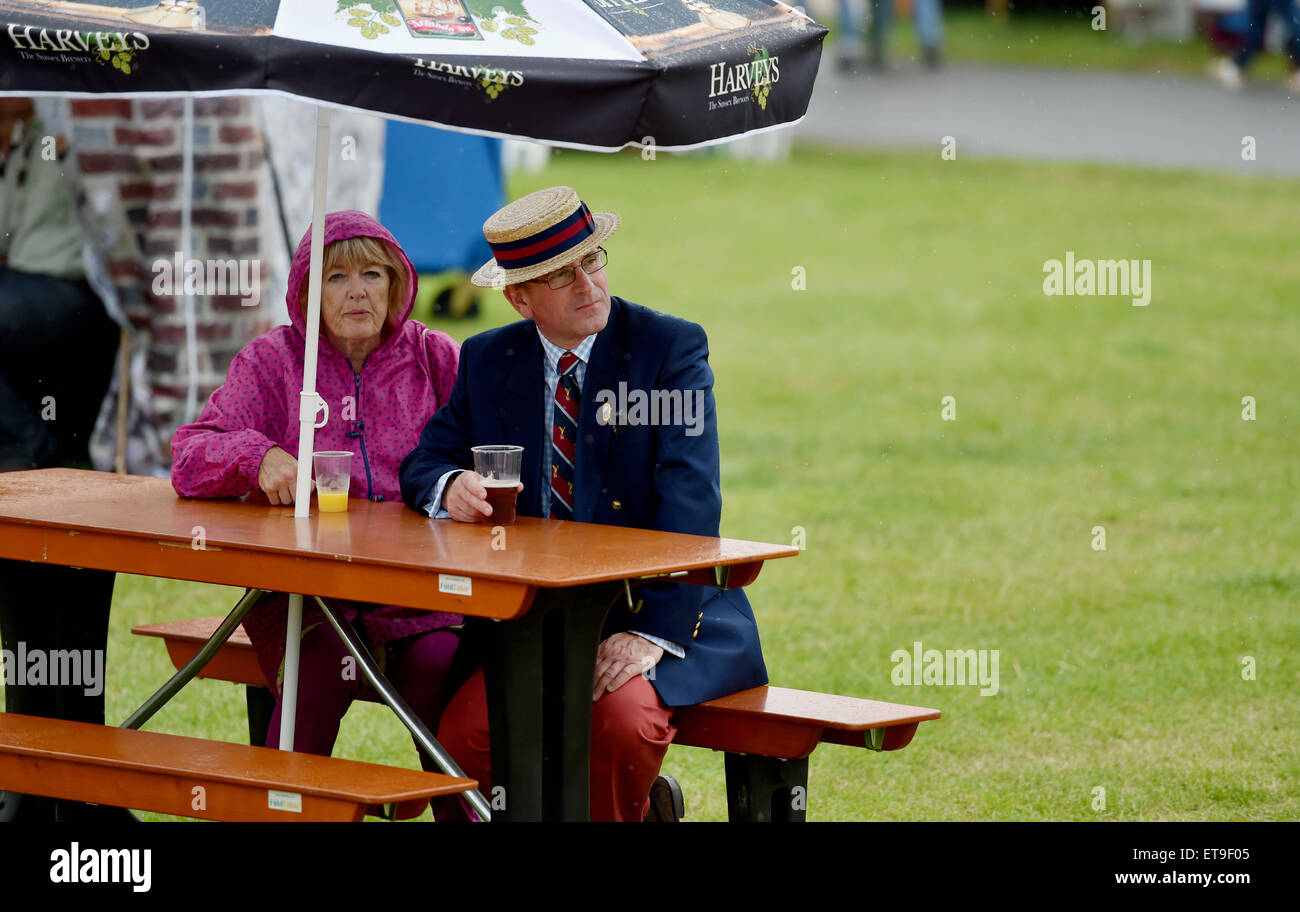 Ardingly Sussex UK 12th June 2015 - A couple don't let the rain stop them enjoying a drink outside at the South - Stock Image