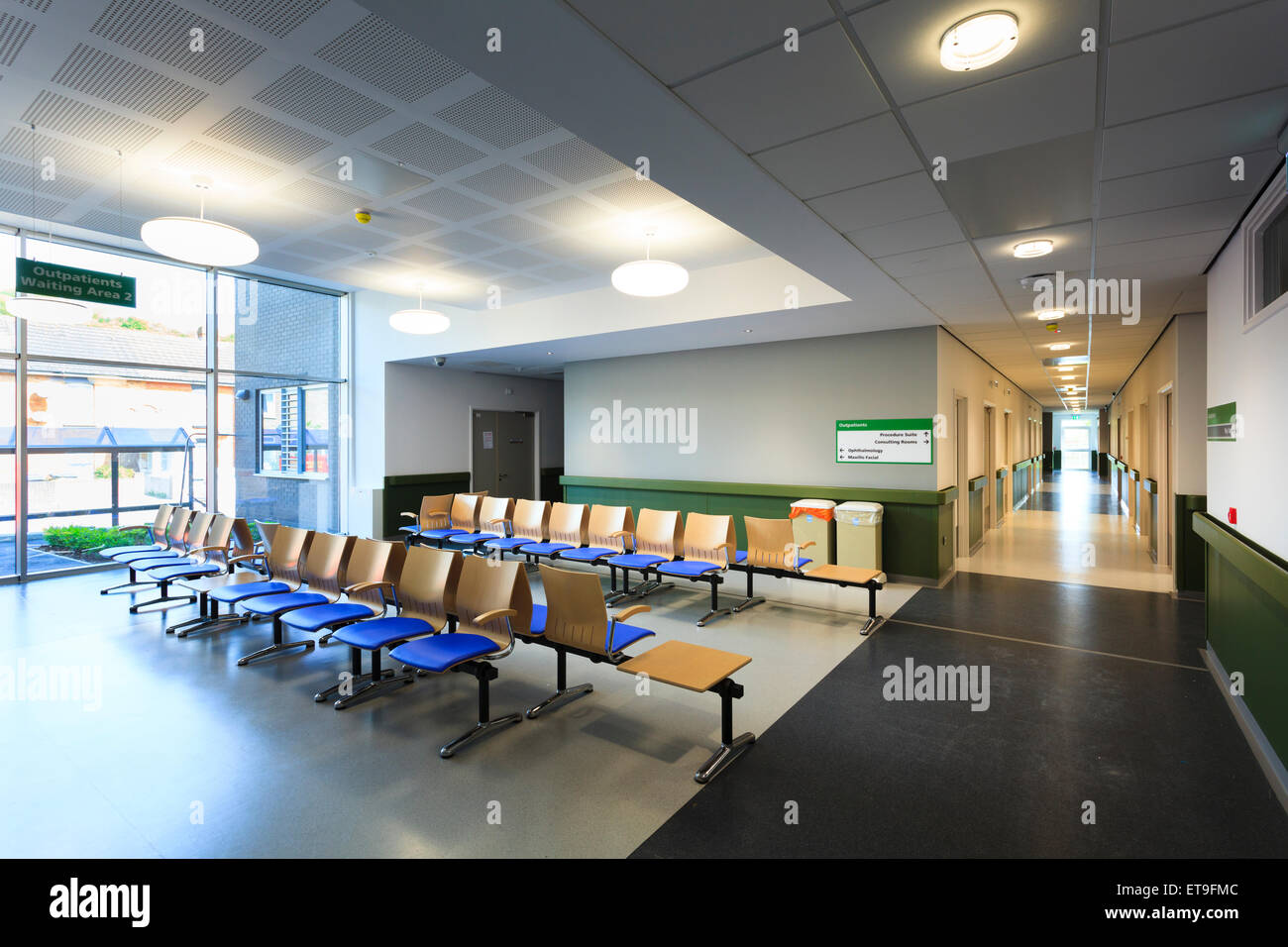 Hospital outpatients waiting area unoccupied without people - Stock Image