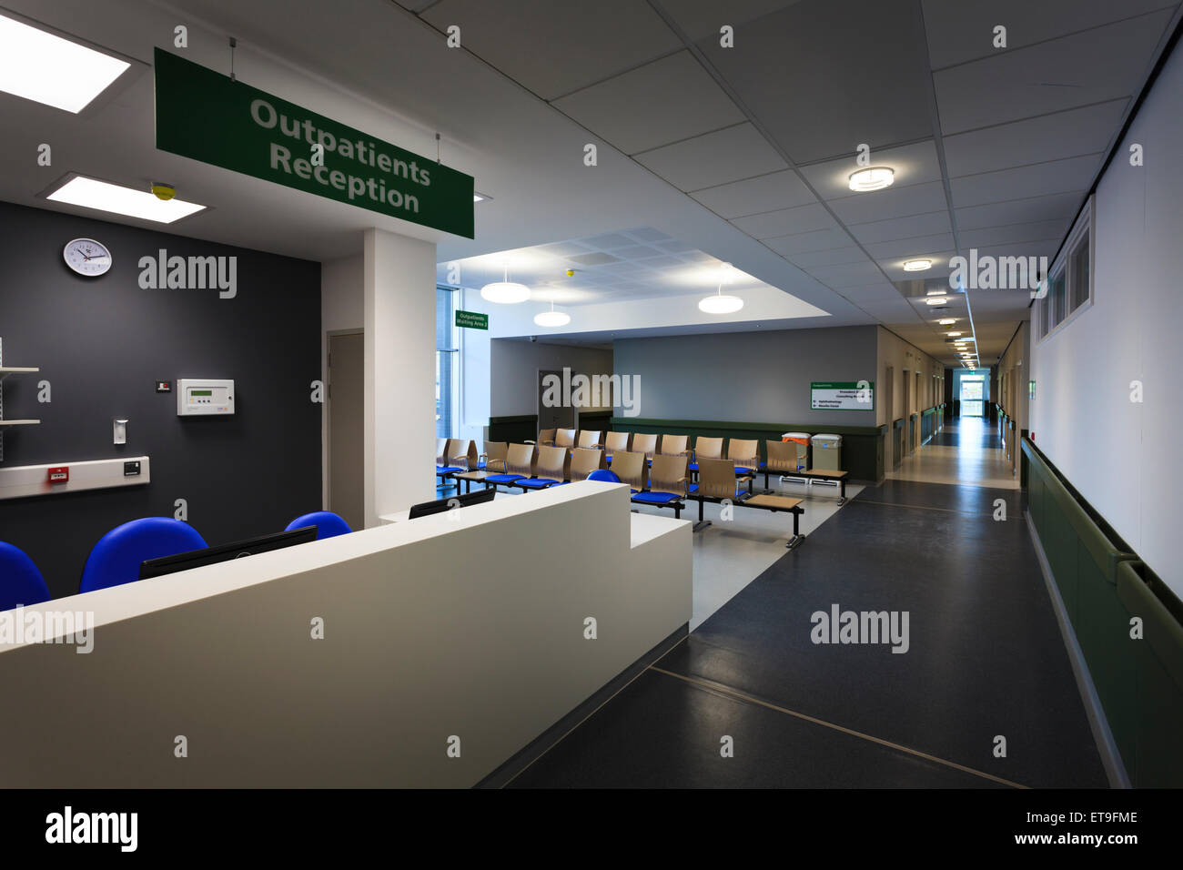 Hospital outpatients reception desk and waiting area without people - Stock Image