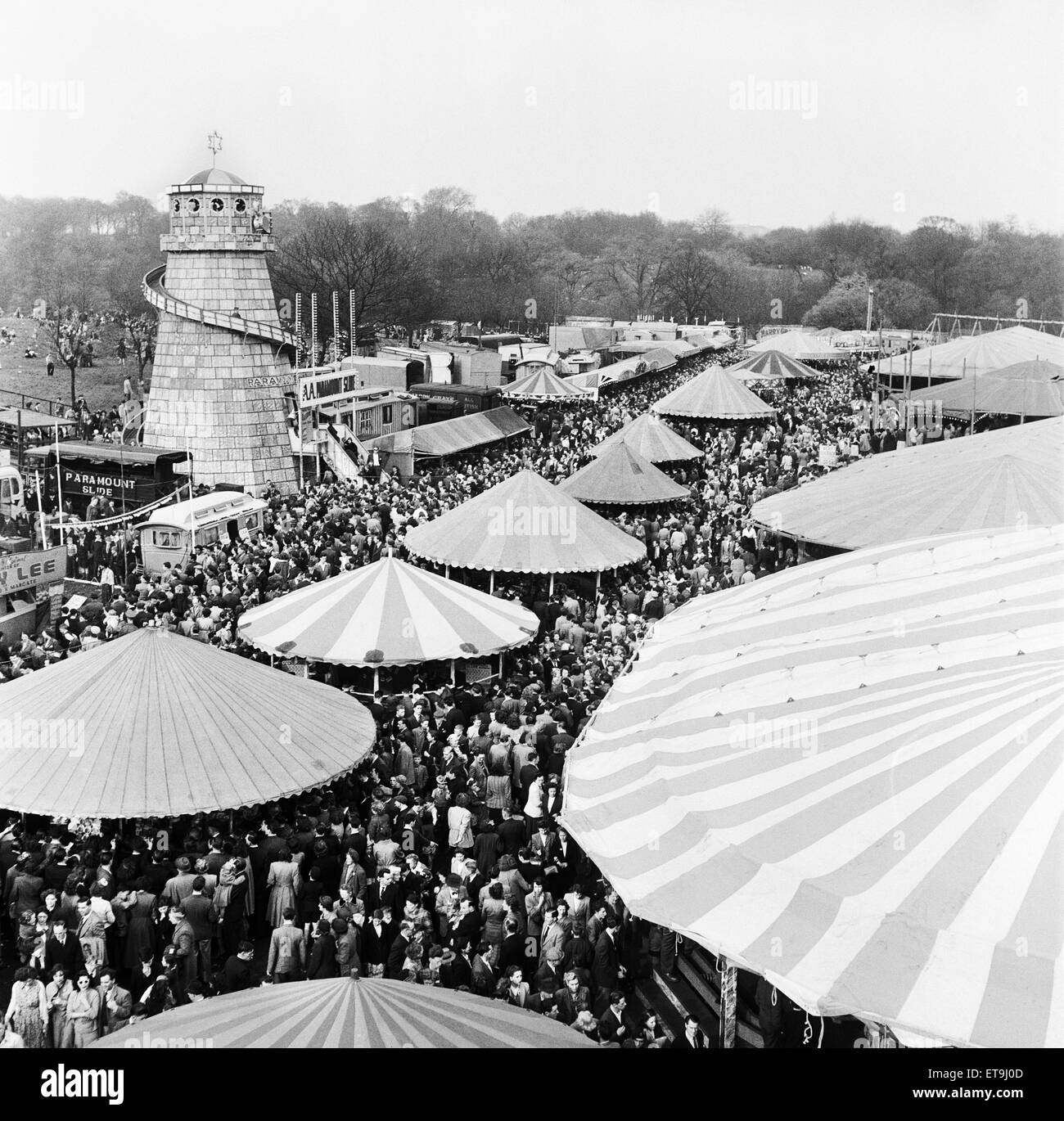 The fine weather brought the crowds out to Happy Hampstead. The famous fair ground at one time was so crowded people - Stock Image