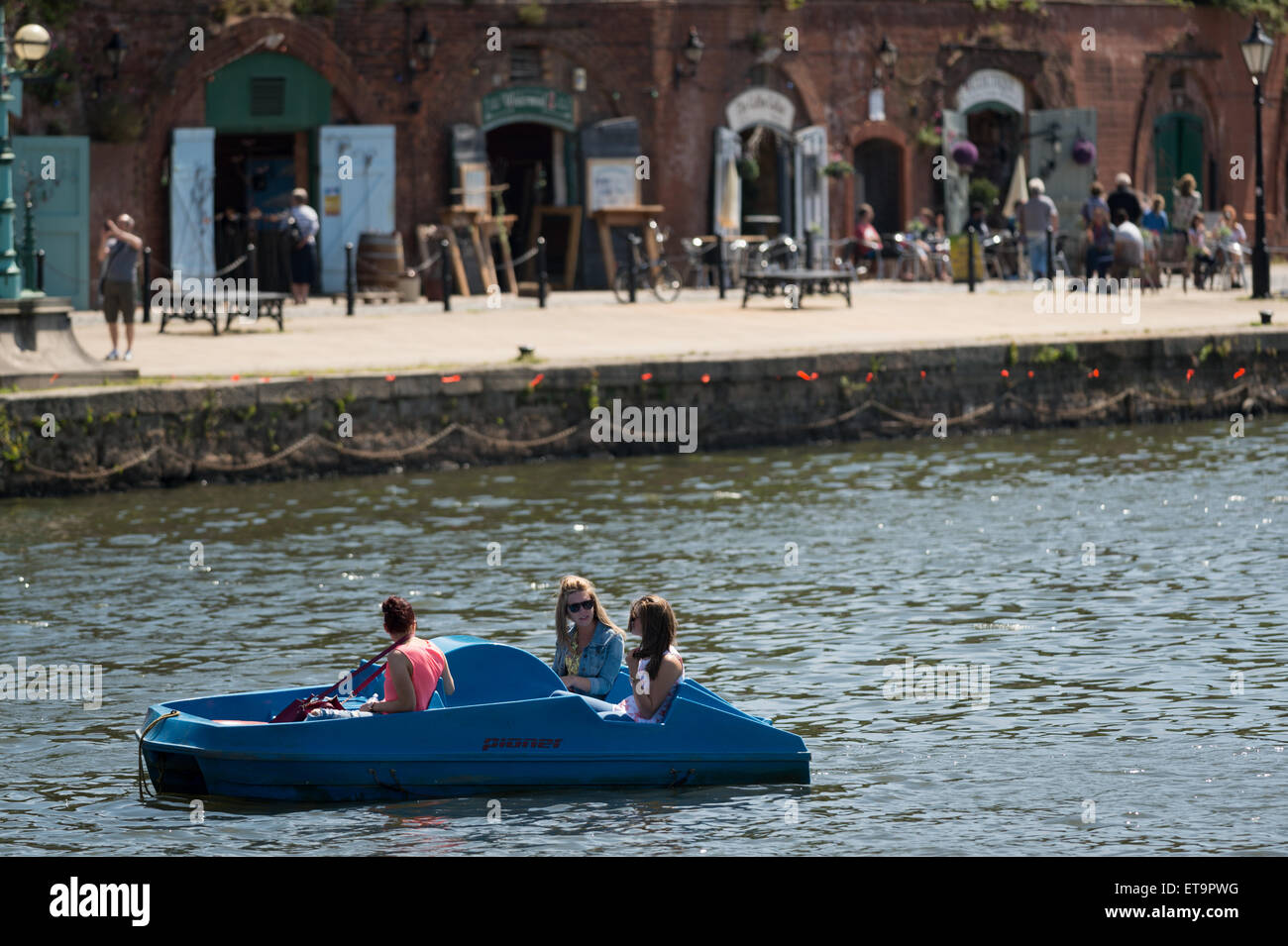 Girls in a pedalo in Exeter Quay, Devon, UK. - Stock Image