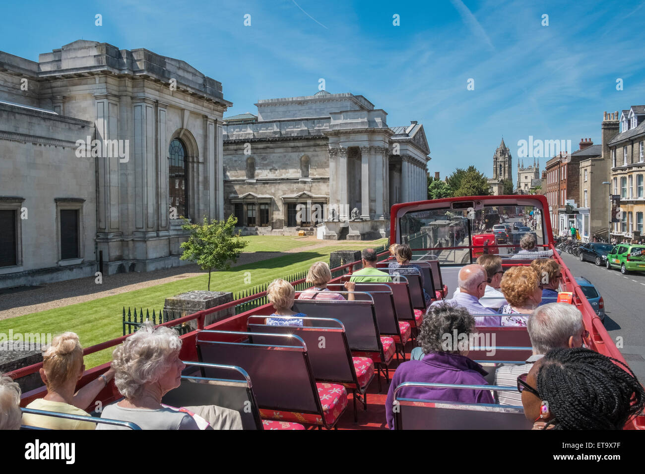 Tourists on open top city sightseeing bus near Fitzwilliam Museum, Trumpington Street, Cambridge, England UK - Stock Image