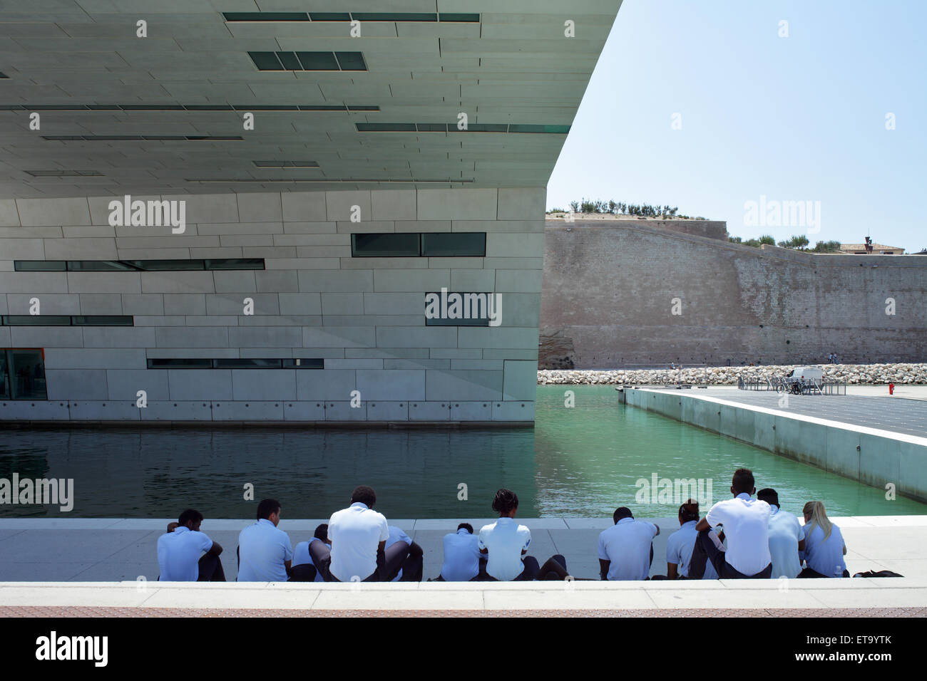 Marseille, France, group of young people sitting in the shade of MuCEM Stock Photo
