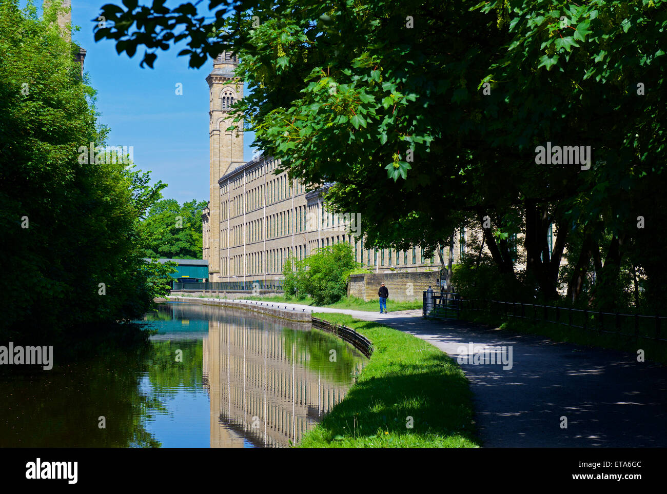 Salt's Mill and the Leeds-Liverpool Canal, Saltaire, West Yorkshire, England UK - Stock Image