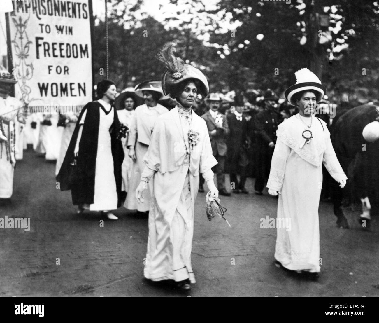 Lady Pethick-Lawrence (right) and Mrs Pankhurst lead a Suffragette demonstration, Christabel Pankhurst (in black & white) follows behind her mother. Circa 1910. Stock Photo