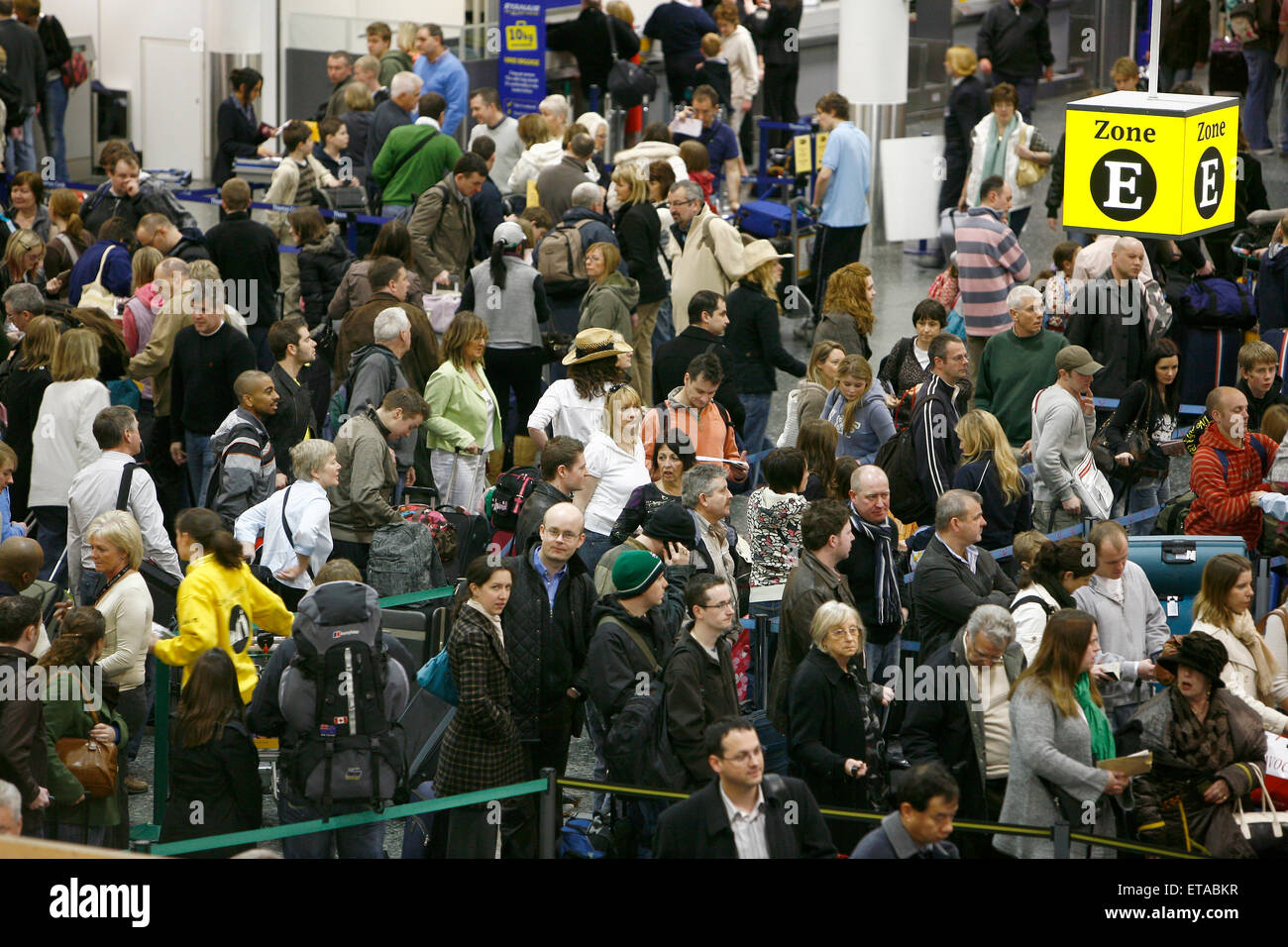 Travelers in the South terminal of London's Gatwick Airport queue to check in.Picture by James BoardmanStock Photo