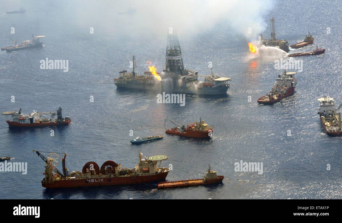 The Discoverer Enterprise and the Q4000 continue to flare off gasses as vessels gather around the ruptured riser Stock Photo