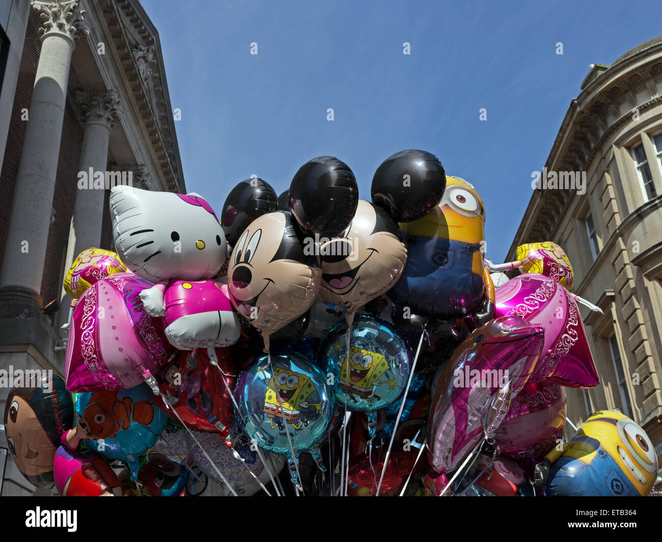 Balloons being sold by a street vendor, Bristol, England Stock Photo